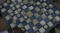 Man dancing while playing checkerbord, Goree Island, Senegal Stock Footage