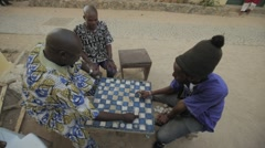 Goree Island residents playing checkerboard, Goree, Senegal Stock Footage