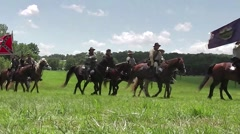 Battle of Gettysburg 150th Anniv - Confederates on horseback with rebel flag Stock Footage