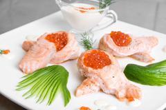 Roasted salmon filet with red caviar Stock Photos