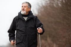 Senior man nordic walking - stock photo
