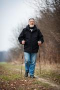 Senior man nordic walking Stock Photos