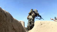 War in Afghanistan - U.S. Marines in fire fight with Taliban - stock footage