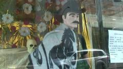 Santa Muerte and Jesus Malverde Figure at Street Shrine, Mexico Stock Footage