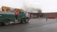Fire department and firefighters deal with smokey electrical fire in building - stock footage