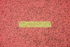 White lines and texture of running racetrack, red rubber racetracks in outdoo - stock photo