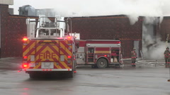 Stock Video Footage of Fire department and firefighters deal with smokey electrical fire in building