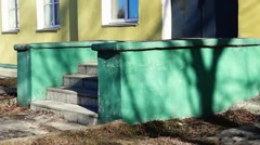 Stairs of old yellow building Stock Footage