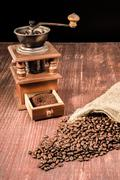 Old Coffee Grinder and Beans - stock photo
