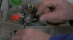 Chainsaw tooth sharpening for wood cutting with an electric tool with sparks Stock Footage