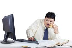 Fear manager watching a monitor Stock Photos