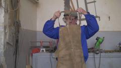 Carpenter preparing to labor in workshop Stock Footage