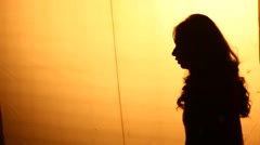 Silhouette of female dancer Stock Footage
