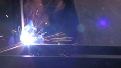 Welder at work in factory - stock footage