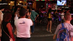 Walking Street is red-light district with restaurants, go-go bars and brothels - stock footage