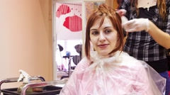 Woman getting haircut and coloring - stock footage