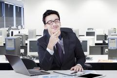 Thoughtful manager imagine something in office - stock photo