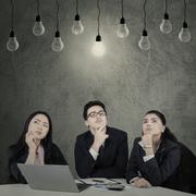Three entrepreneurs find the solution Stock Photos