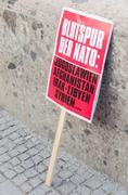 Munich, Germany – February 07, 2015: Protest sign placard of anti-NATO rally Kuvituskuvat