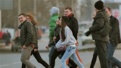 A group of young, active, cheerful people crossing the road Stock Footage
