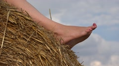 Woman feet relaxing on haystack, free soles Stock Footage