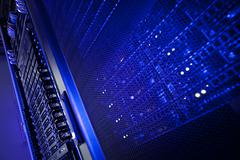 Server rack cluster in a data center (shallow DOF; color toned i Stock Photos