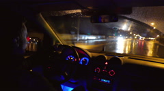 The man drive the car (chase), inside view, control panel, wheel, wide angle Stock Footage
