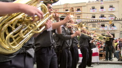 Brass musicians accompanying the street parade group Stock Footage
