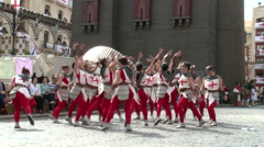 Group of girls with cross costumes dancing on street, wider Stock Footage