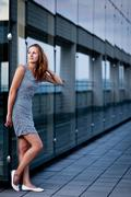 Young woman posing inside a modern top architecture building com Stock Photos