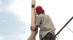 Builder worker at roofing construction works Stock Footage