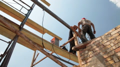 Construction workers on scaffold doing welding work Stock Footage
