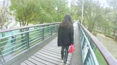 Raised wooden walkway in Xujiahui park Shanghai. Stock Footage