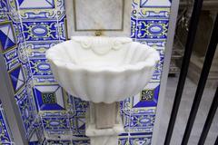 White marble baptismal font Stock Photos