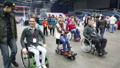 A Lot of people with disabilities in wheelchairs at the stadium Stock Footage