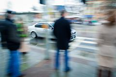 urban traffic concept - city street with busy traffic (color ton - stock photo
