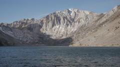 4K Winter lake and mountain peaks morning Stock Footage