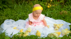 Baby girl with chicks in the garden Stock Footage
