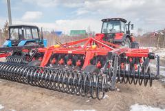 Tractor with hinged equipment. Tyumen. Russia - stock photo