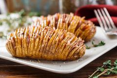 Hasselback potatoes Stock Photos