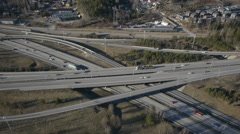 Aerial drone view from 140m height, crossroads traffic Kehä III and E18 highway Stock Footage