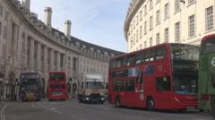 Narrow street in London, low britain car traffic, landmark red bus double decker - stock footage