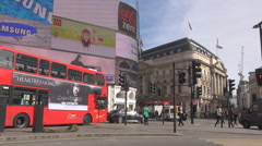 Red bus double decker London cityscape, Piccadilly Circus shopping mall, british - stock footage