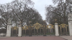 Buckingham Palace garden entrance gate golden victorian art detail, british view Stock Footage