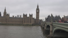 Double decker cars tourists move on Westminster bridge, britain Parliament view Stock Footage