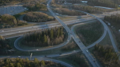 Aerial view 140m height, highway crossroads at sunset Stock Footage
