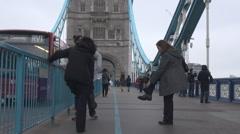 Tourists on Tower Bridge, double decker bus drive, London cityscape downtown - stock footage
