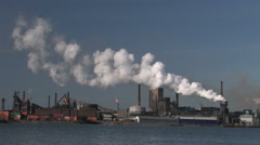 View of a large steel mill in Sweden with smoking chimney Stock Footage