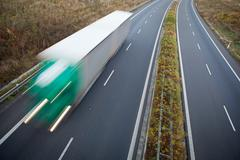 Highway traffic - motion blurred truck on a highway/motorway/spe Kuvituskuvat