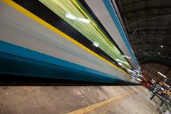 modern train departing from/arriving to a modern train station ( - stock photo